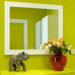Come fissare uno specchio a parete